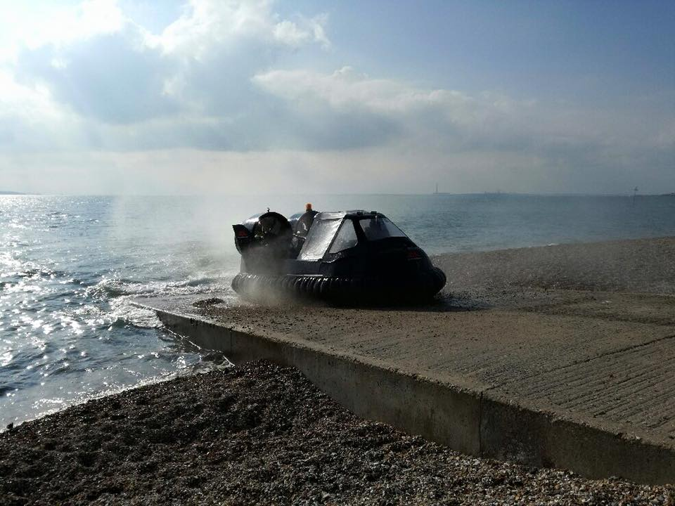 An ex-Heathrow Airport rescue craft exiting the water onto a concrete slipway after it's first successful flight after a refit.